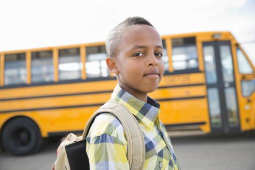 Child boarding school bus