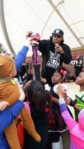 Reec AKA Eazy E, handing out candy bags