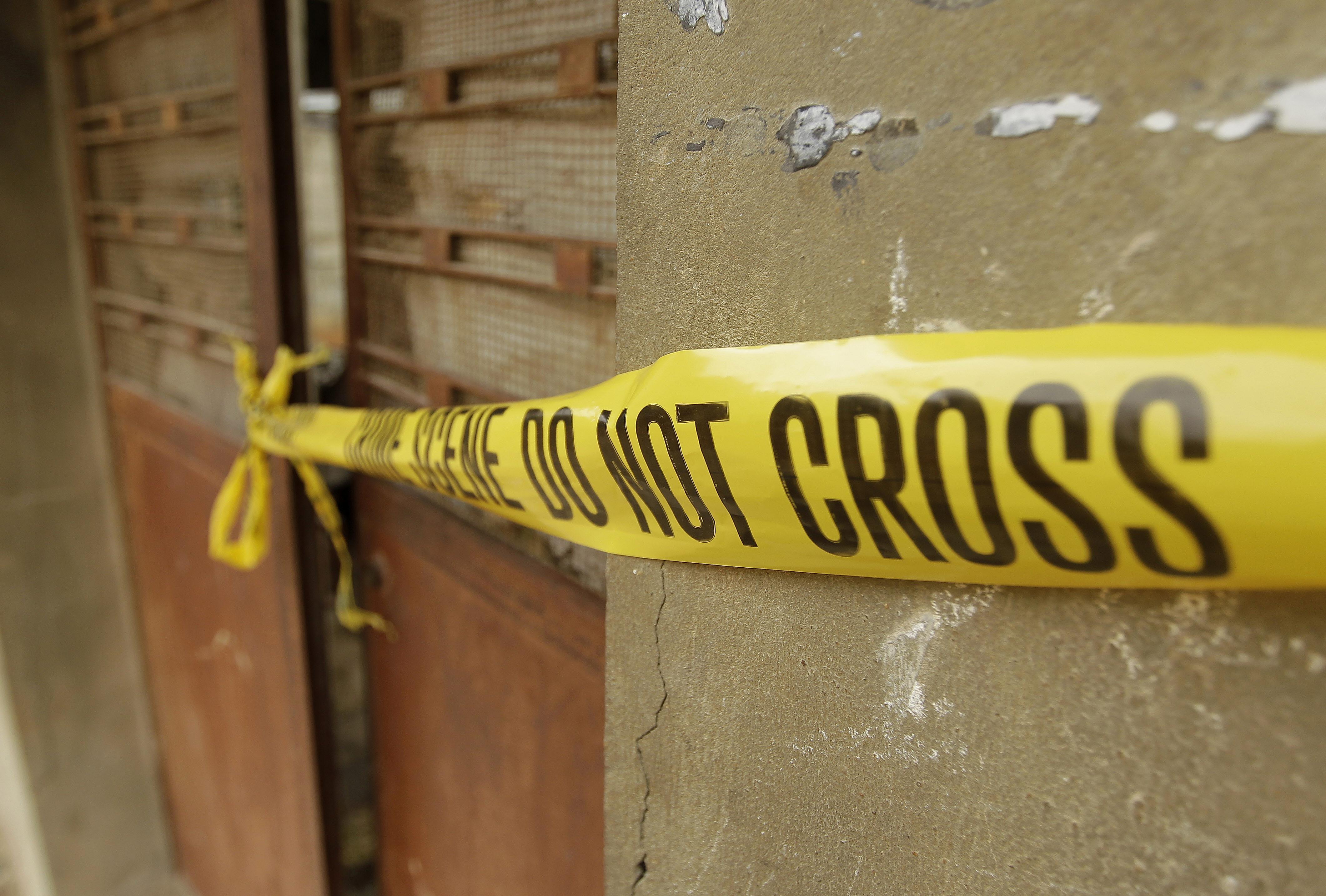 Police tape cordons off the crime scene