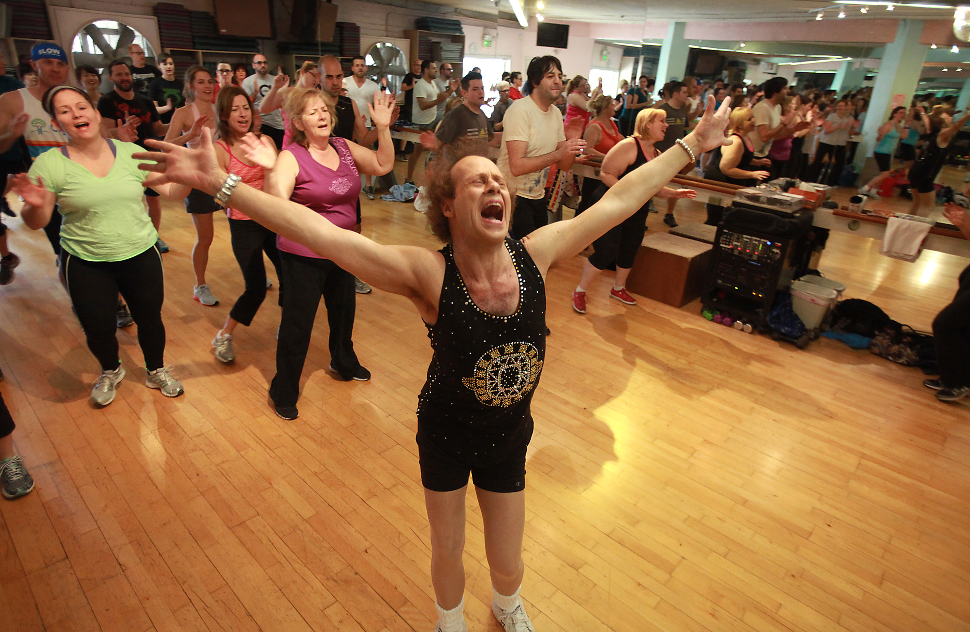 Fitness guru Richard Simmons sings alone with one the the 60s classic tunes playing during one of h