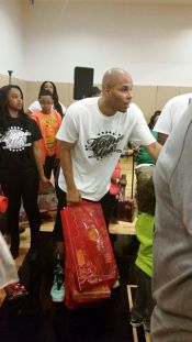 reec-hands-out-toysat-hoopin-for-tots-e1418575991363