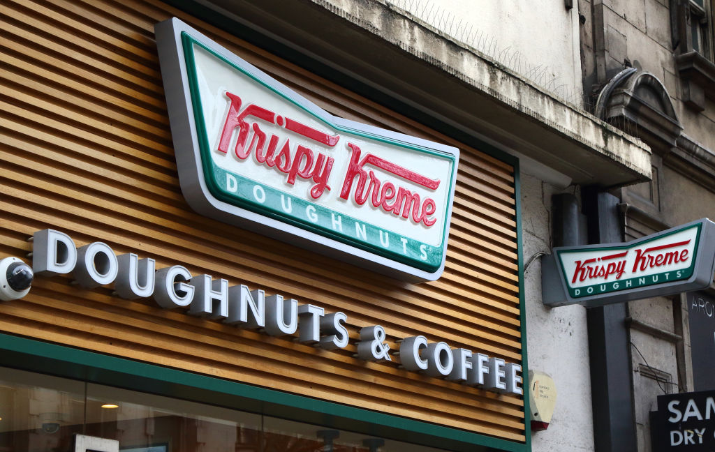 Krispy Kreme store and brand logo seen in London, UK...