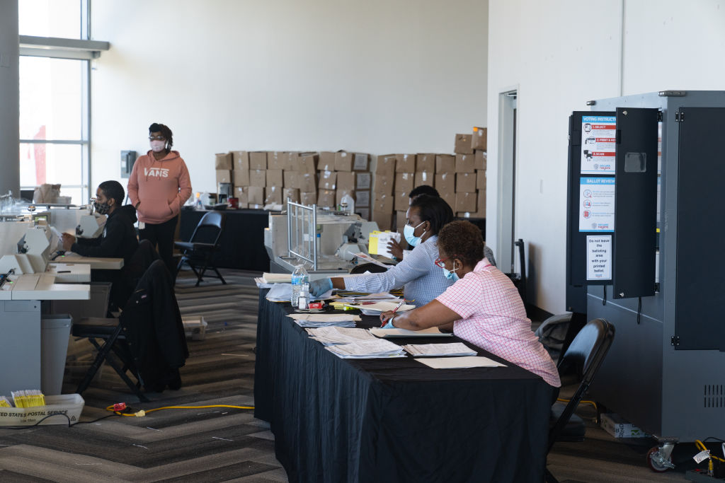 Fulton County Officials Process Absentee Ballots In Atlanta's State Farm Arena